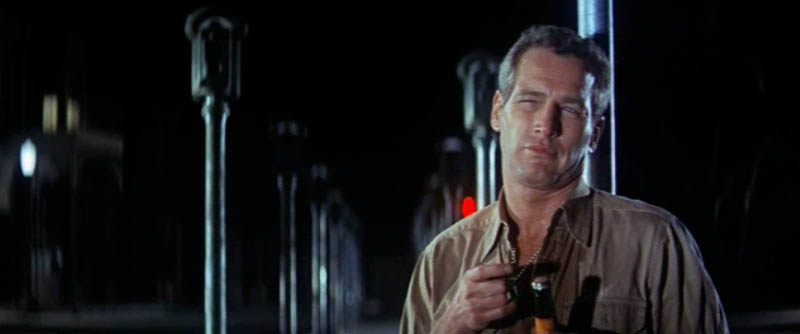 """parking meter violation in cool hand luke Remember the scene early on in """"cool hand luke"""" when paul newman whacks the heads off those parking meters  would smack down cities like la that ticket ."""